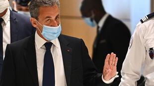 France's former president Nicolas Sarkozy arrives at the court in Paris on March 1, 2021.