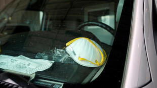 A protective face mask is seen on the dashboard of an ambulance in Shawnee, Oklahoma, on April 2, 2020.
