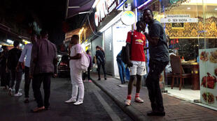 "People gather on a street in the ""Little Africa"" district of Guangzhou, the capital of southern China's Guangdong province, on March 2, 2018."