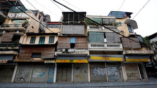 Closed shops are seen on an empty Hang Duong street which was previously one of the most busy streets during the coronavirus disease (COVID-19) outbreak in Hanoi, Vietnam April 20, 2020.