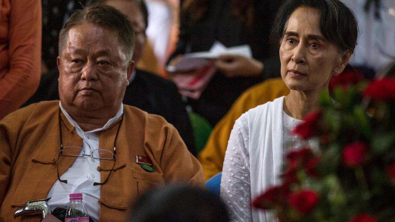 In this file photo, Win Htein (L) and Aung San Suu Kyi, chief executive committee members of the National League for Democracy (NLD), attend the funeral service for the party's former chairman Aung Shwe in Yangon on August 17, 2017.