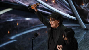 "Director Bong Joon-ho accepts the Oscar for Best Foreign Language Film for ""Parasite"" of South Korea at the 92nd Academy Awards in Hollywood, Los Angeles, California, U.S., February 9, 2020."