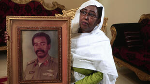 Awatef Mirghani holds a portrait of her brother Esmat, a Sudanese officer who was executed following the 1990 coup attempt