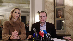 Jeanne Der Agopian, press relations officer of the French charity SOS Chretiens d'Orient (Christians of the Middle East), and Benjamin Blanchard, the charity's director general, give a news conference in Paris on January 24, 2020, after four of the NGO's members went missing in the Iraqi capital of Baghdad.