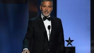 Actor and activist George Clooney, seen here in 2018, says that the toppling of Sudan's veteran leader Omar al-Bashir is not sufficient