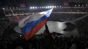 A spectator waves the Russian flag ahead of the opening ceremony of the February 2018 Winter Olympic Games in Pyeongchang, South Korea