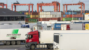 Freight container lorries are pictured at Dublin Port in Dublin, Ireland on January 12, 2021.