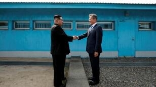 North Korea's leader Kim Jong Un (L) and South Korea's President Moon Jae-in have met three times in 2018 -- the first was in April at the truce village of Panmunjom but they first shook hands at the Military Demarcation Line dividing their nations