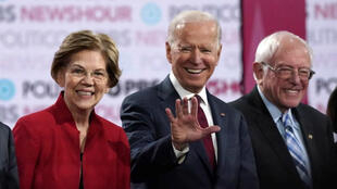 Democratic presidential candidates Senator Elizabeth Warren, former Vice President Joe Biden and Senator Bernie Sanders onstage before the start of the sixth Democratic presidential campaign debate at Loyola Marymount University in Los Angeles, California, on December 19, 2019.