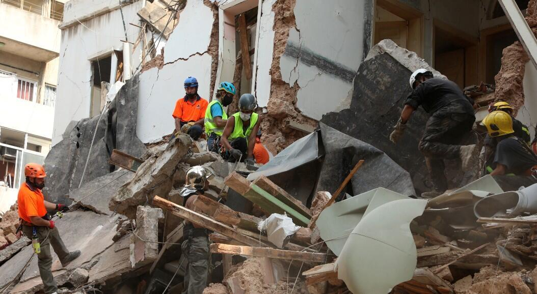 A team of rescuers sift through the rubble in Beirut.