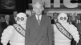 "A file picture taken on October 5, 1984, shows Francois Michelin posing with the family company's iconic ""Michelin Man"""