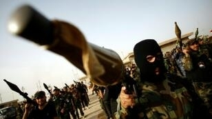 Members of the Saraya al-Salam militia linked to powerful Iraqi Shiite cleric Moqtada al-Sadr march in Iraq's holy city of Najaf on May 17, 2016