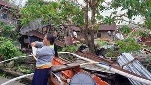 A woman is seen near storm debris in Biliran, Philippines on December 26, 2019.