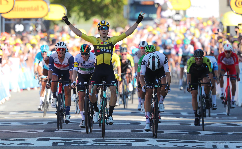 Team Jumbo-Visma rider Wout Van Aert of Belgium celebrates as he finishes ahead of Team Sunweb rider Cees Bol of the Netherlands and Deceuninck-Quick Step rider Sam Bennett of Ireland, between Gap to Privas, September 2, 2020.