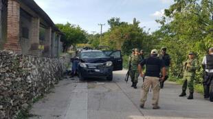 Fotografía cedida que muestra el sitio donde un soldado y 14 civiles murieron durante un enfrentamiento entre civiles armados y miembros del Ejército mexicano en el estado de Guerrero, el 15 de octubre de 2019.