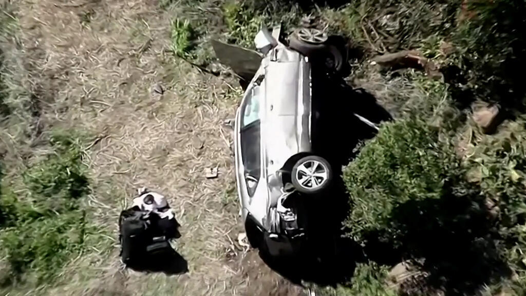 Golfer Tiger Woods' car lies on its side after being involved in a one-car accident in Los Angeles.