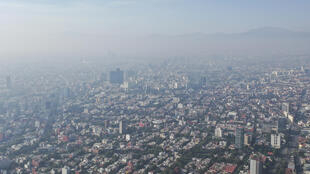 Air pollution in Mexico City. Global CO2 emissions need to drop 45 percent by 2030 and reach 'net zero' by 2050 to limit temperature rises at 1.5 degrees Celsius
