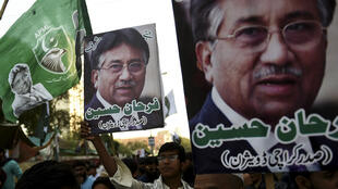 Demonstrators carry pictures of former military ruler Pervez Musharraf during a protest in Karachi on December 24, 2019, following a special court's verdict.