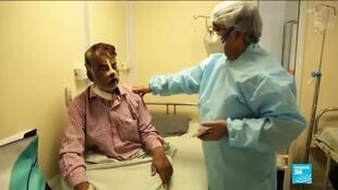 Dr Brij Pal Tyagi speaks with a patient infected with mucormycosis, also known as black fungus, at Harsh Ent Hospital in Ghaziabad, Uttar Pradesh, India.