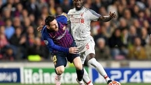 Guinea star Naby Keita (R) playing for Liverpool against Lionel Messi of Barcelona during a UEFA Champions League semi-final last month