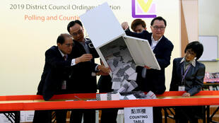 Officials open a ballot box at a polling station in Kowloon Tong, Hong Kong, on November 24, 2019.