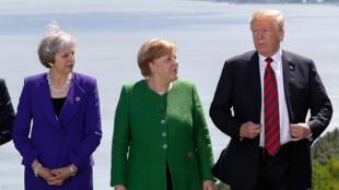 La primera ministra británica Theresa May, la canciller alemana Angela Merkel y el presidente estadounidense Donald Trump durante la cumbre del G7 en la ciudad de La Malbaie, Quebec, Canadá