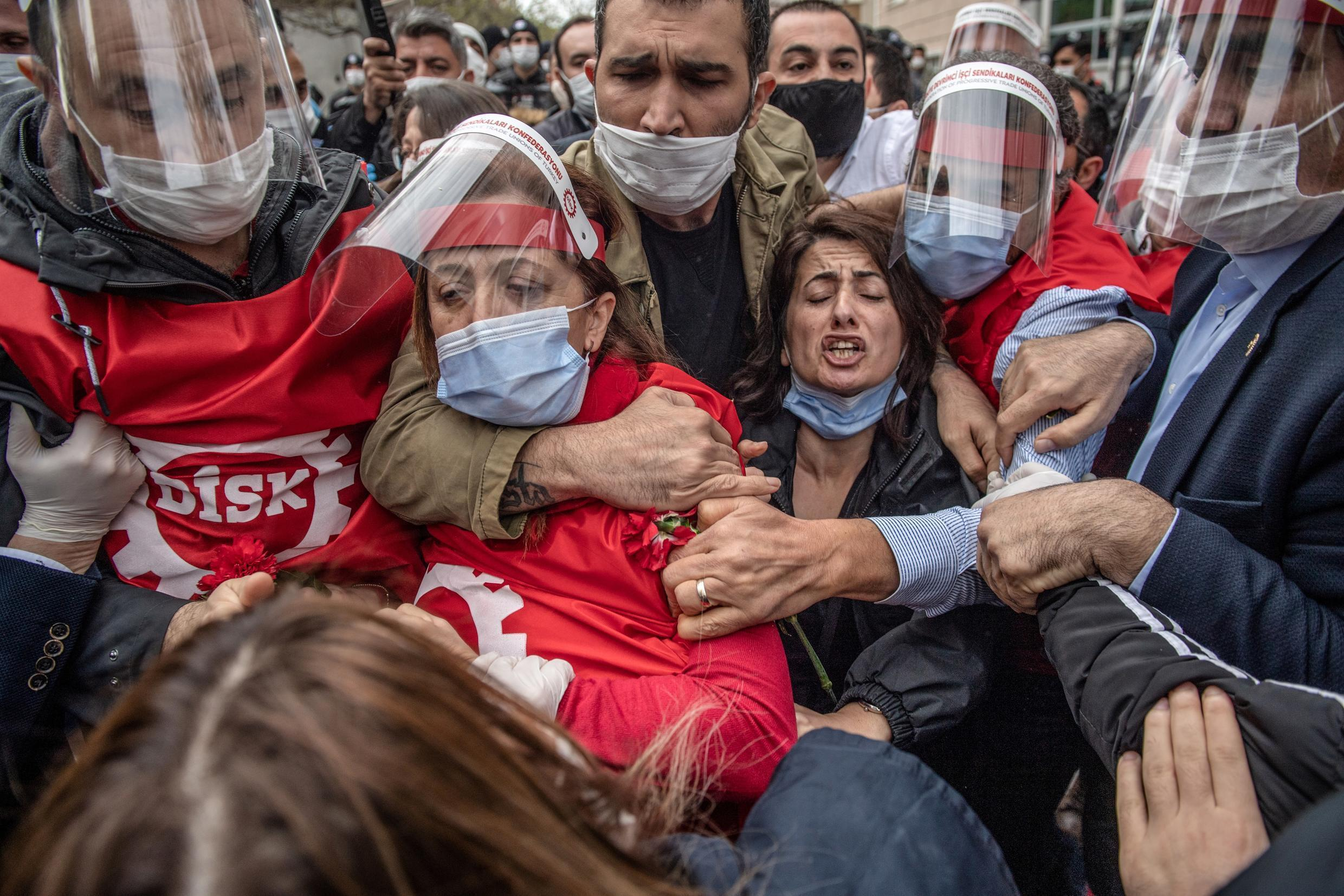 Demonstrators wrestle with Turkish police during a Labour Day rally in Istanbul, on May 1, 2020.