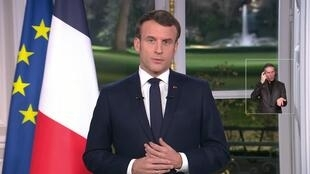 French President Emmanuel Macron delivers his annual televised New Year's Eve address Dec. 31, 2019.