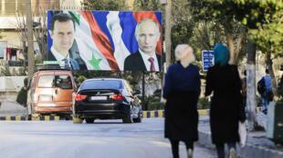 Poster géant du président Bachar al-Assad et de son homologue russe, Vladimir Poutine, à Alep, le 9 mars 2017.