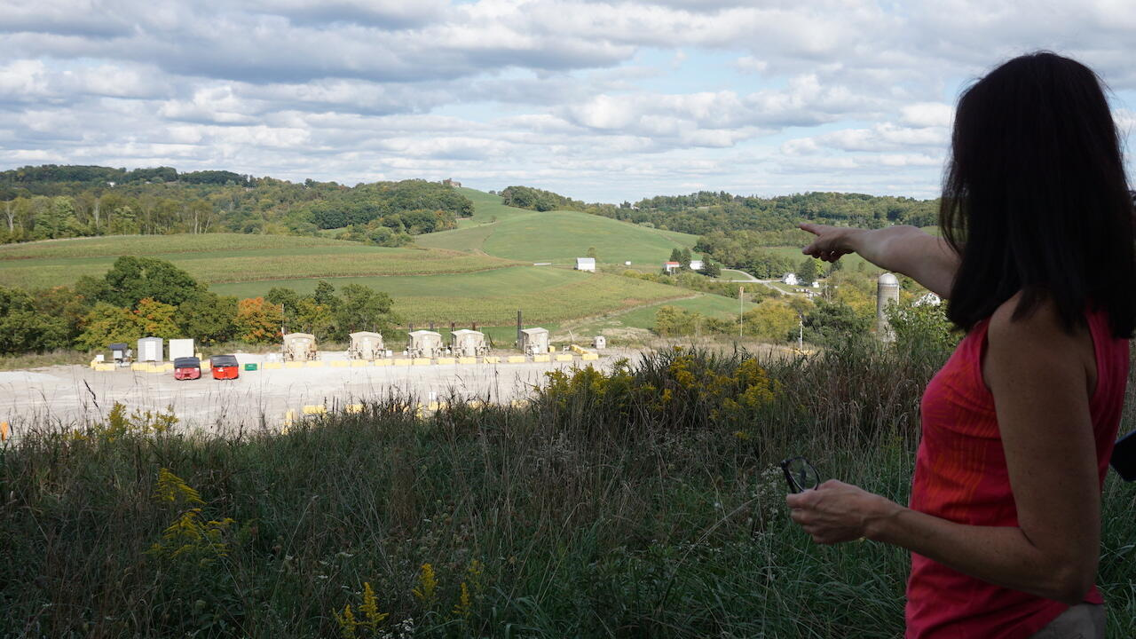 Lois Bower-Bjornson, southwestern Pennsylvania field organizer with Clean Air Council, points out a fracking well site just over the hill from her home in Scenery Hill, Pennsylvania.