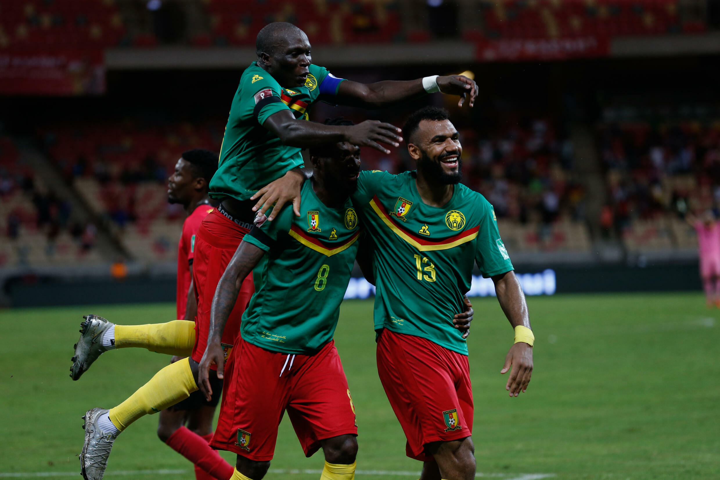 Cameroonian Eric Maxim Choupo-Moting (right) celebrates his goal against Mozambique in a World Cup qualifying match in Douala on Friday.