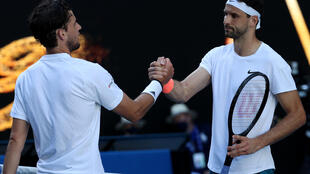 Grigor Dimitrov (right) shakes hands with third seed Dominic Thiem after knocking him out of the Australian Open