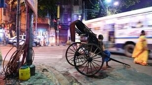 A rickshaw runner waits for passengers in Kolkata -- the last city in India where the mode of transport survives