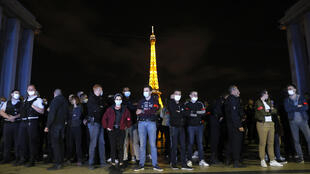 File photo of French police officers protesting in front of the Eiffel Tower in Paris on June 14, 2020.