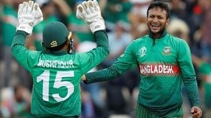 Bangladesh's Shakib Al Hasan (right) celebrates his dismissal of Afghanistan's Najibullah Zadran in their World Cup meeting