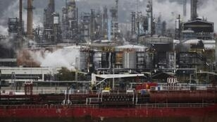 Falling oil prices helped limit increases in the price consumers pay for energy of all kinds in December