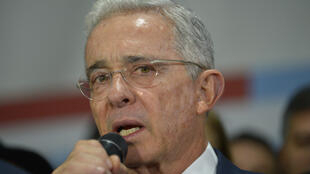 Former Colombian president Alvaro Uribe speaks to supporters in October 2019 at the headquarters of the Democratic Center political party in Bogota, after his hearing at the Supreme Court over witness tampering
