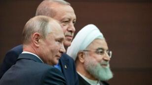 Le président russe Vladimir Poutine, le président turc Recep Tayyip Erdogan et le président iranien Hassan Rouhani, à l'issue d'une réunion trilatérale sur la Syrie à Ankara, le 16 septembre.