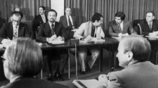 Sheikh Ahmed Zaki Yamani (2nd-L), oil minister of Saudi Arabia, attends negotiations in 1973 in Vienna between the Organization of Petroleum Exporting Countries (OPEC) and  representatives of  Westerner petroleum firms