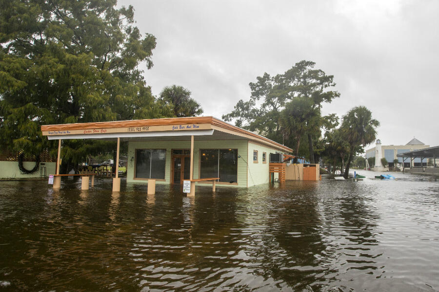 The Cooter Stew Café starts taking water as Hurricane Michael pushes the storm surge up the Wakulla and Saint Marks Rivers, which come together here, in Saint Marks, Florida, on October 10, 2018.