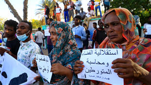Relatives of Sudanese protesters slain by the previous regime rally in Khartoum in March 2021 as the country transitions to democracy