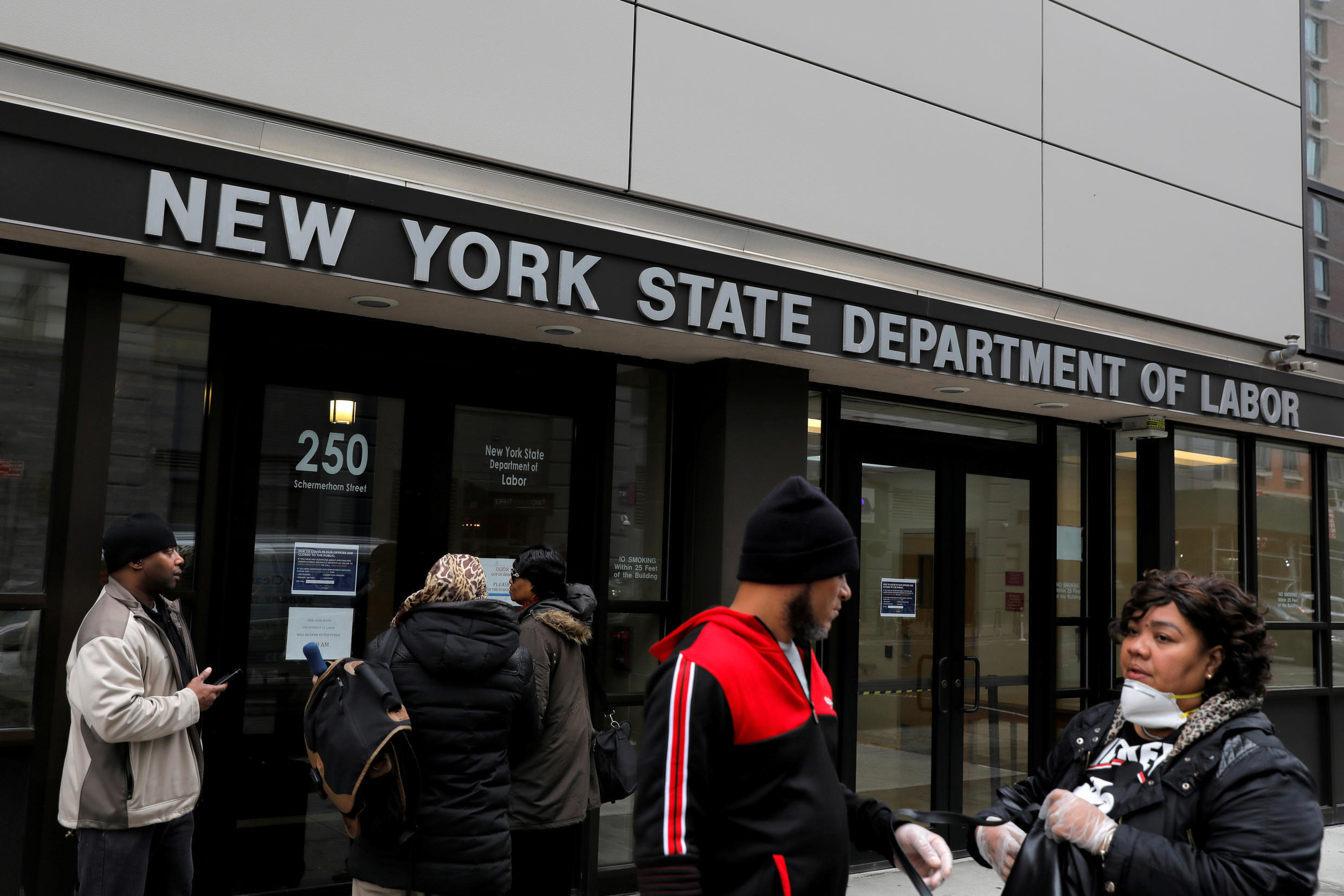 File photo taken March 20, 2020 of people gathering outside the New York State Department of Labor offices.