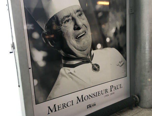 """A poster in Lyon thanks """"Monsieur Paul"""", as Paul Bocuse was commonly known in his hometown."""