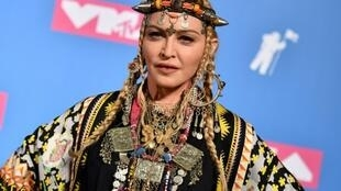 Despite several bouts of controversy and travel demands, Madonna says she is staying in Portugal
