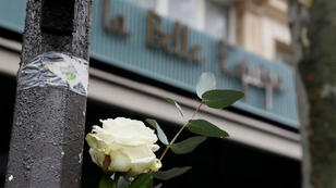 A picture taken on November 13, 2016 shows a white rose near La Belle Equipe bar and restaurant to mark the first anniversary of the Paris terror attacks.