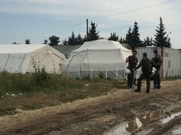 Security forces inside the Idomeni refugee camp as it is evacuated on May 24, 2016.
