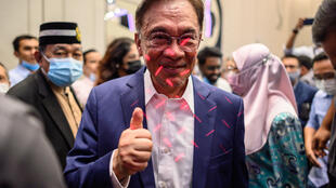 Veteran politician Anwar Ibrahim -- who has long sought to become prime minister -- said he now had the backing of enough MPs to form the government