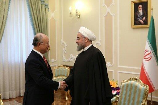 الرئيس الإيراني (يمين) مستقبلا رئيس الوكالة الدولية للطاقة الذرية  20 أيلول/سبتمبر