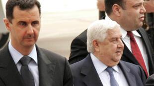 Bachar al-Assad et le chef de la diplomatie syrienne Walid Mouallem (Archives).