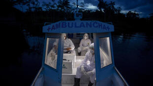 Health workers from the city of Melgaco ride a boat ambulance after visiting a small riverside community on Marajo Island, state of Para, Brazil